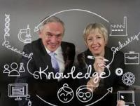 Alison Campbell is doing something funny with Richard Bruton T.D. Ireland's Minister for Jobs, Enterprise & Innovation